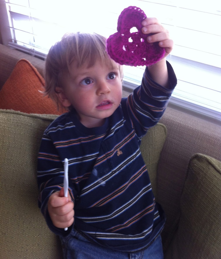 Calvin holding up one of the very first hearts I made.